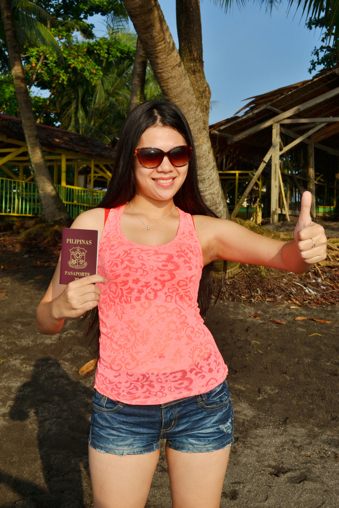woman holding Philippine passport